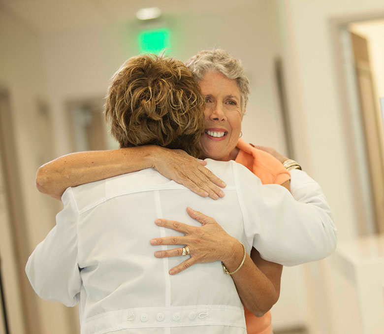 Patient being hugged by a hospital staff member